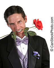 Tux & Rose - A handsome man in a tuxedo with a red rose...