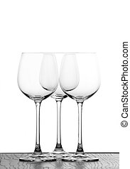 three wine glasses in backlight