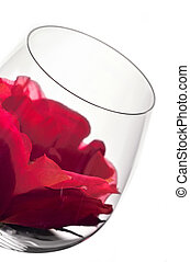 wine glasses and flower - wine glass in backlight with red...