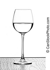 wine glass - one wine glass in backlight on white contrast...