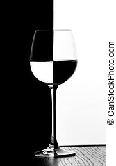 domino wine glass - one wine glass in backlight on the black...