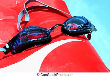 Swimming Goggles - Blue swimming goggles on red boogie...