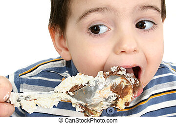 Eating Possum Pie - Close up of a two year old boy eating...