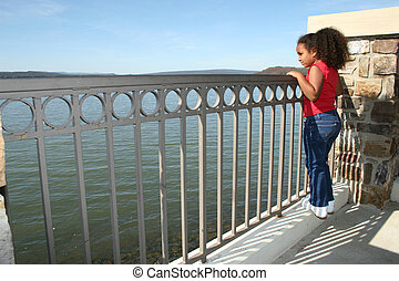 Girl Child Arkansas - Pretty little girl looking out at the...