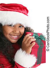 Child Christmas Gift - Happy little girl in red Christmas...