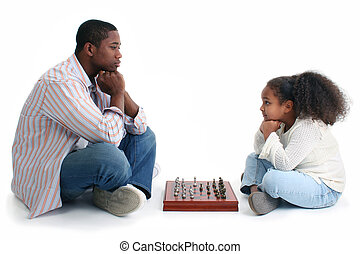 Father Child Chess - African American man and little girl...