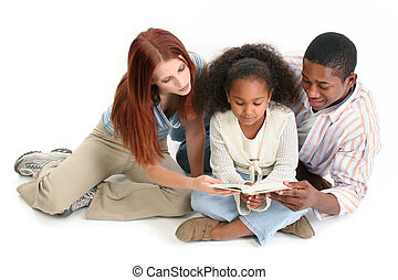 Mom Dad Daughter - Family of three reading child's bible...