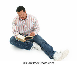 Man Book Sitting - African American man reading book. Casual...