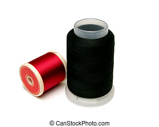 Spools of thread - Red and Black spools of thread over white...