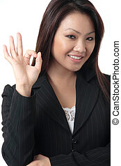 "Business woman giving the ""OK\"" signBusiness woman giving..."