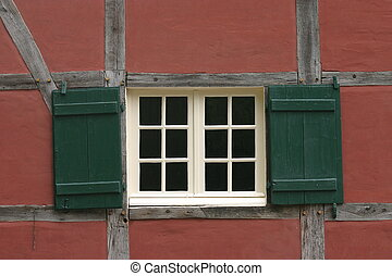 Window in red wall - Window with green shutters in red wall