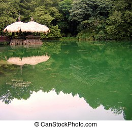 Quiet Lake - -- with a thatched straw roof pavilion