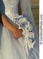 wedding bouquet - a women holds her bouquet