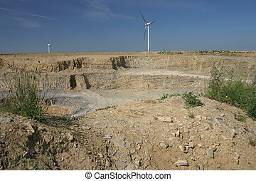 Quarry with windmills