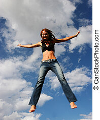 Woman jumping of joy - Woman jumping in the air of joy