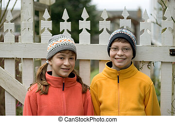 Kids in Ski Hats and Fuzzy Pullovers - Photo of Kids in Ski...