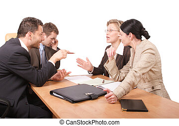 Business negotiations - 2 men 2 women sitting at the desk in...