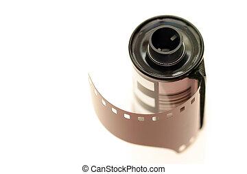 35mm film over white - roll of 35mm film - macro shot over...