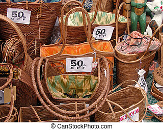 Sales season - Discounts on a wooden woman bags stall in a...