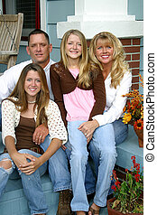 Beautiful Family Together - A beautiful blond family sitting...