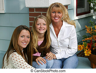 Mother and Daughters - A beautiful blond mother and her...