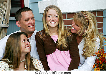 Center Of Attention - An attractive family all looking at...