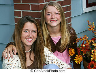 Lovely Sisters at Home - Two beautiful sisters on the front...