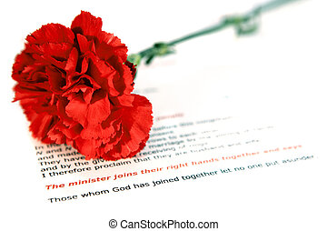 Wedding rites - A red carnation lying on the order of...