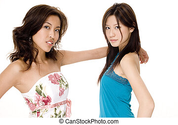 J and G 2 - Two beautiful young asian women in casual...