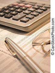 Office Objects - calculator and pen (narrow focus on the...