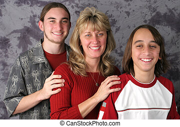 Mom & Sons Portrait 1 - An attractive mother and her two...