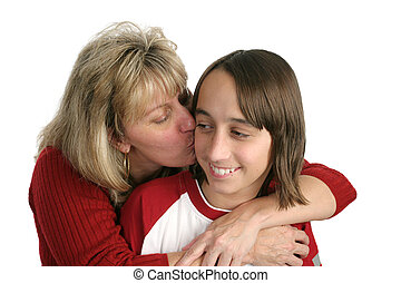 Mom Kisses Boy - A mother giving a kiss on the cheek to her...