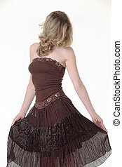Lady in brown dress - lady in brown dress holding out the...