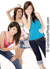 Listening To Music #2 - Three attractive young asian women...