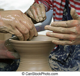 Pottery - Student learning how to make pottery