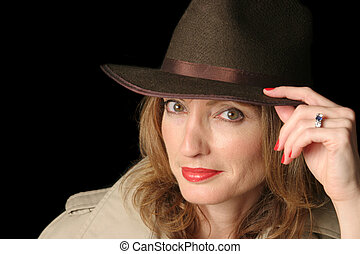 Sexy Female Agent - A beautiful woman in a smiling in a hat...
