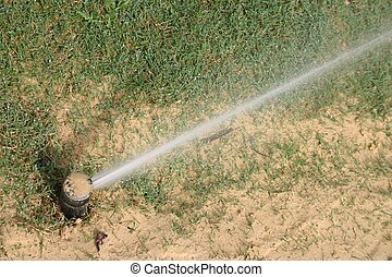 Lawn Irrigation - Pop up lawn irrigation system to water...