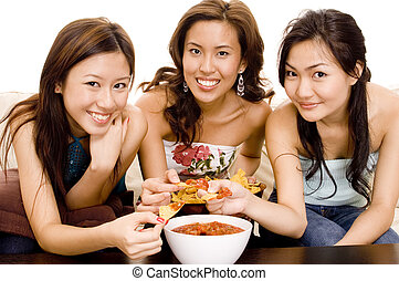 Nachos and Salsa 2 - Three pretty asian women eating nachos...