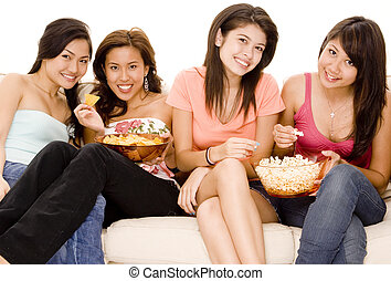 Girls Night In 3 - Four attractive young women sitting on a...