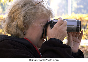 woman amateur photographer - digital amateur photographer