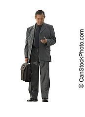 businessman with cell-phone isolated - businessman standing...