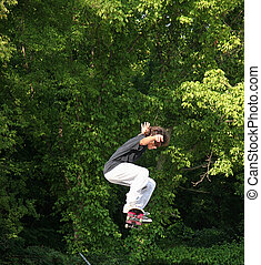 Skateboarder Jumping Near Trees