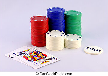 Texas Hold Em - Five stacks of colored poker chips with the...