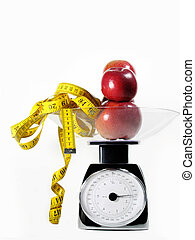Healthy Diet - Kitchen scale, apples and measuring tape