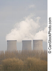 Power Station Pollution - Three power station cooling towers...
