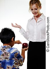 apple for teacher - Boy showing teacher apple and teacher...