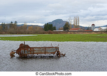 Flooded Antique Farming Equipment 2 - Photo of piece of...