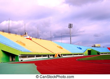 Sports Stadium Sideview - -- against a rain filled sky