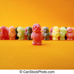 one jelly babies standing out from the crowd the background...