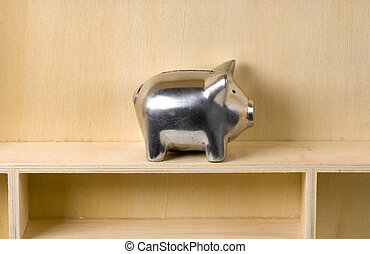 Piggy Bank on a Wooden Shelf